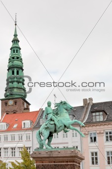 tower St. Nicholas Church and Statue of Absalon in Copenhagen