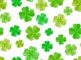 seamless background with green shamrock.