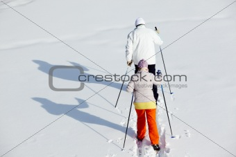 Backs of skiers
