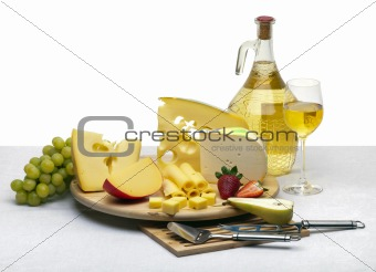 Cheese still life on a wooden round tray
