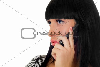 Portrait of the girl speaking on the phone. Isolated