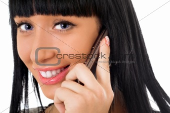 Portrait of the smiling girl speaking on the phone