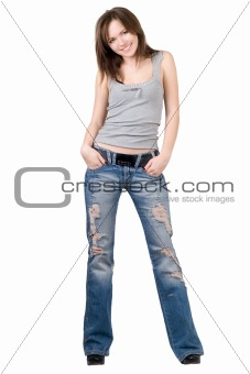 Beautiful young woman in a blue jeans. Isolated
