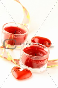 two red hearts and  candle for valentines day