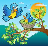 Two blue birds with tree branch
