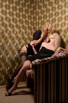 beautiful two woman on the couch