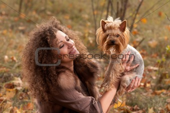 woman and a little dog