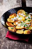 fried potatoes in an iron pan 