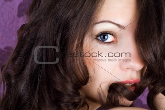 Portrait of the young woman with dark blue lenses