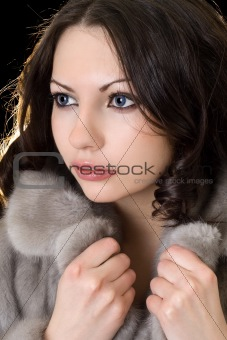 Pretty young woman in a fur coat