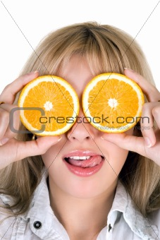 Portrait of the funny girl with oranges over white