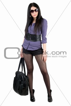 Pretty young brunette with a black handbag. Isolated
