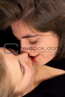 two girls kissing