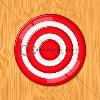Red target on the wooden wall