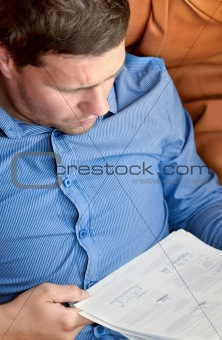 Businessman analyzing a sheet