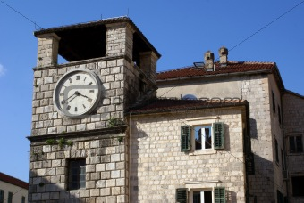 Clock tower and house