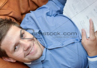 Satisfied businessman smiling