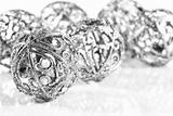 Silver balls on white background