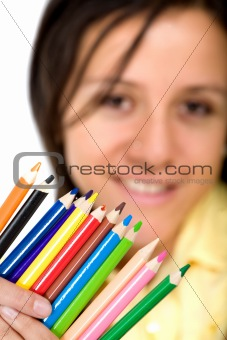 girl holding colour pencils