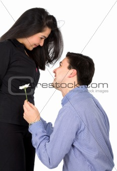 man offering a flower to his girlfriend