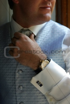 Groom Adjusting his tie