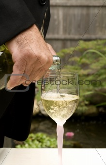Groom Pouring White Wine