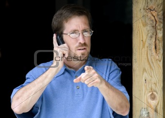 Business Man Pointing while on Phone