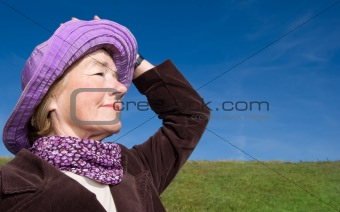 Happy mature woman on the meadow