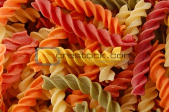 multi colored fusilli twirls pasta background