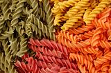 colored fusilli twirls pasta background