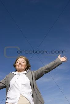 Beautiful, joyful mature woman on the meadow