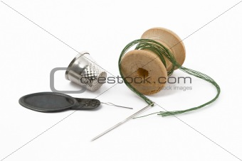 Thread, thimble and needle
