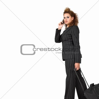 Businesswoman pulling her luggage