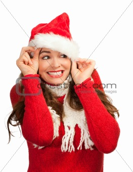 Attractive woman peeking out from santa hat