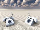 white retro phones in desert