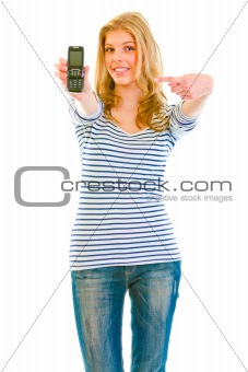 Smiling beautiful teen girl pointing finger on mobile