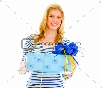 Portrait of beautiful teen girl with present box in hand