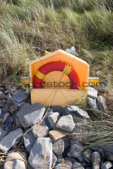 beach lifebuoy buried in the stones