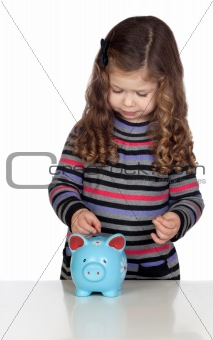 Adorable baby with a blue money-box