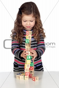 Adorable baby playing with wooden blocks