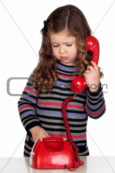 Adorable baby with a red telephone