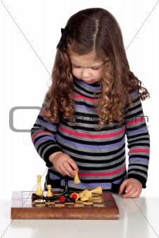 Adorable baby girl playing chess