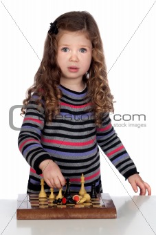 Adorable baby girl playing chess