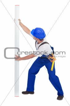 Worker with ruler