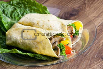 tortilla filled with chicken meat and vegetables
