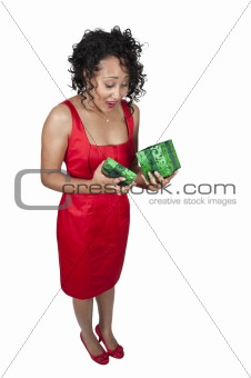 Black Woman Opening a Christmas or birthday present