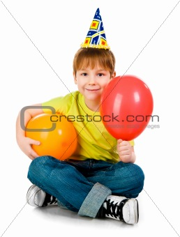 Boy in birthday caps