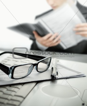 Businessman at office reading a contract