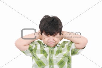 Little boy closing his eyes and ears with his hands, isolated on