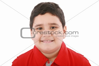 Boy looking at the camera with a small smile over white backgrou